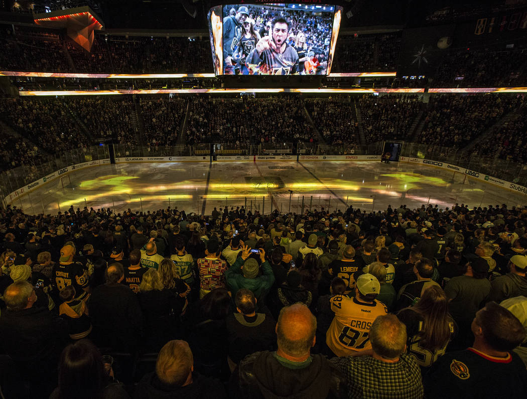Golden Knights fans cheer before the start of Vegas' home matchup with the Pittsburgh Penguins on Thursday, Dec. 14, 2017, at T-Mobile Arena, in Las Vegas. The Golden Knights defeated the Penguins ...