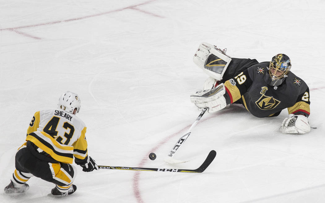 Golden Knights goaltender Marc-Andre Fleury (29) comes out of the box to makes a save against Pittsburgh's Conor Sheary (43) on Thursday, Dec. 14, 2017, at T-Mobile Arena, in Las Vegas. The Golden ...