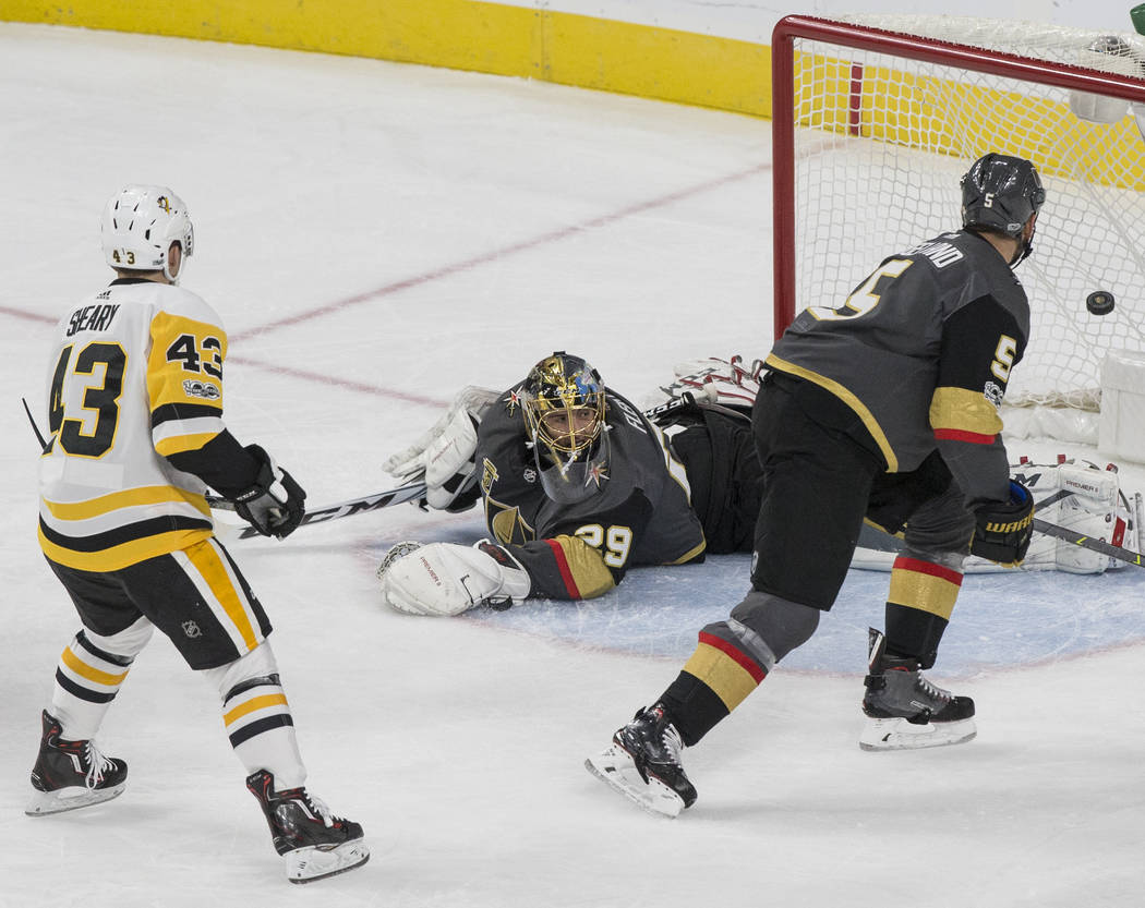 Golden Knights goaltender Marc-Andre Fleury (29) gives up a first period goal as Pittsburgh's Conor Sheary (43) follows the puck on Thursday, Dec. 14, 2017, at T-Mobile Arena, in Las Vegas. The Go ...