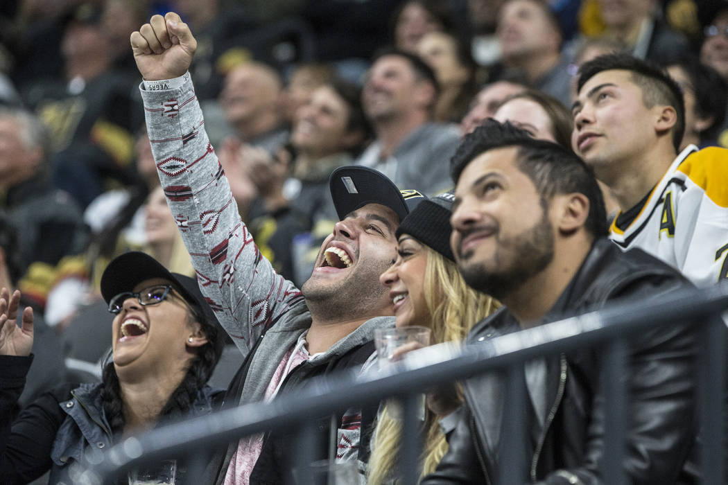 Golden Knights fans cheer during the second period of Vegas' home matchup with the Pittsburgh Penguins on Thursday, Dec. 14, 2017, at T-Mobile Arena, in Las Vegas. The Golden Knights defeated the  ...