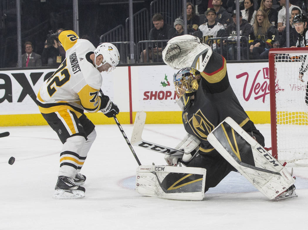 Golden Knights goaltender Marc-Andre Fleury (29) makes a save against Penguins right wing Patric Hornqvist (72) during the second period of Vegas' home matchup with Pittsburgh on Thursday, Dec. 14 ...