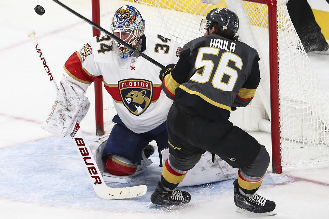 Golden Knights' Erik Haula (56) tries to score on Florida Panthers goalie James Reimer (34) during an NHL hockey game at T-Mobile Arena in Las Vegas on Sunday, Dec. 17, 2017. Chase Stevens Las Veg ...