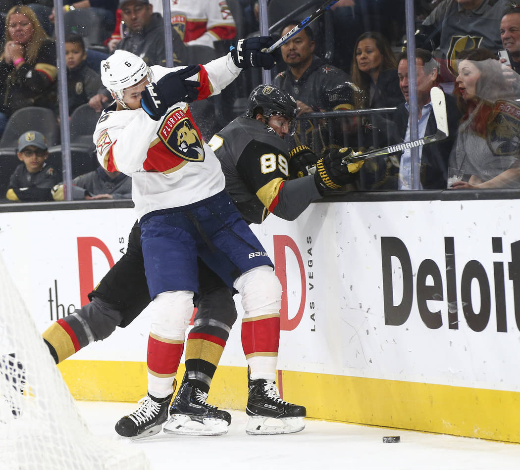 Golden Knights' Alex Tuch (89) gets tripped up by Florida Panthers' Alexander Petrovic (6) during an NHL hockey game at T-Mobile Arena in Las Vegas on Sunday, Dec. 17, 2017. Chase Stevens Las Vega ...