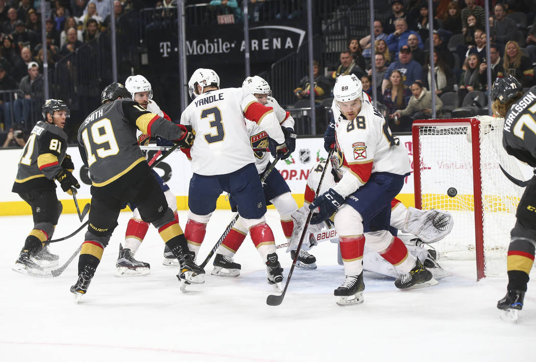 The puck flies by the goal as Golden Knights players attempt to score on the Florida Panthers during an NHL hockey game at T-Mobile Arena in Las Vegas on Sunday, Dec. 17, 2017. Chase Stevens Las V ...