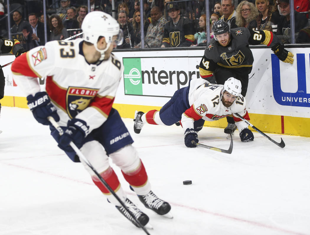 Florida Panthers' Ian McCoshen (12) gets tripped up by Golden Knights' Oscar Lindberg (24) during an NHL hockey game at T-Mobile Arena in Las Vegas on Sunday, Dec. 17, 2017. Chase Stevens Las Vega ...