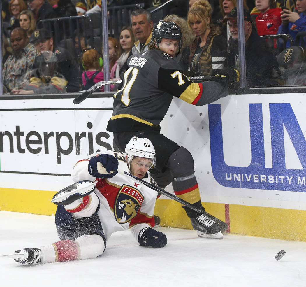 Florida Panthers' Evgenii Dadonov (63) gets tripped up by Golden Knights' William Karlsson (71) during an NHL hockey game at T-Mobile Arena in Las Vegas on Sunday, Dec. 17, 2017. Chase Stevens Las ...