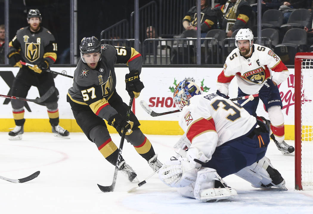 Florida Panthers' goalie James Reimer (34) defends against a shot from Golden Knights' David Perron (57) a during an NHL hockey game at T-Mobile Arena in Las Vegas on Sunday, Dec. 17, 2017. Chase  ...