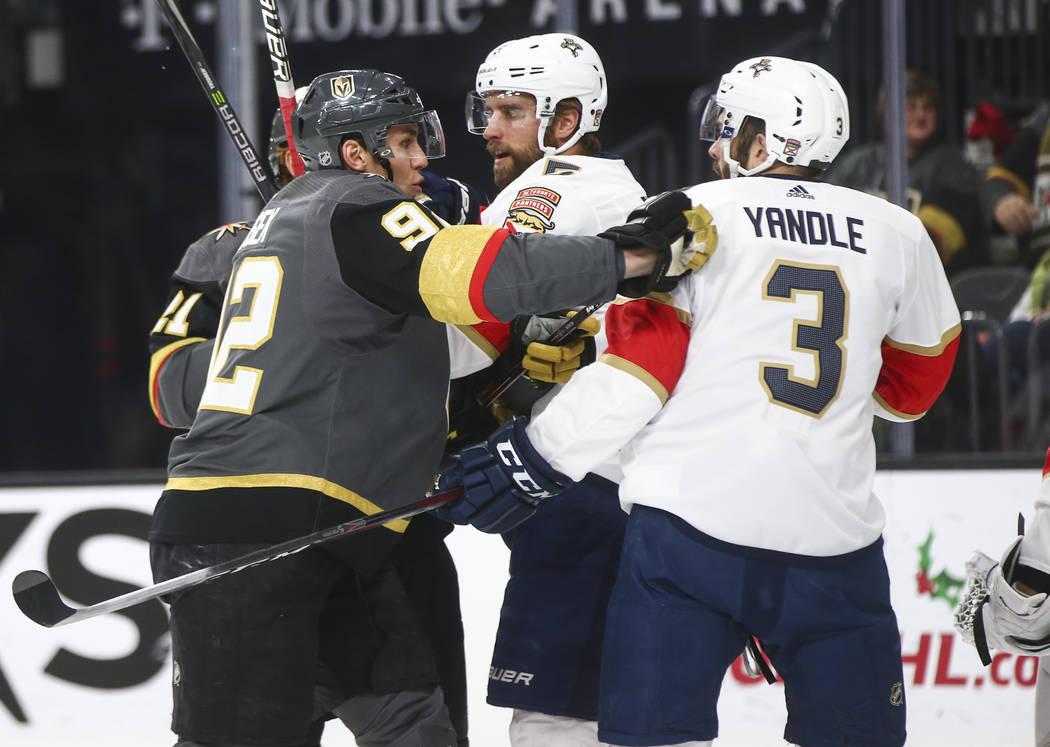 Golden Knights' Tomas Nosek (92) shoves Florida Panthers' Keith Yandle (3) during an NHL hockey game at T-Mobile Arena in Las Vegas on Sunday, Dec. 17, 2017. Chase Stevens Las Vegas Review-Journal ...
