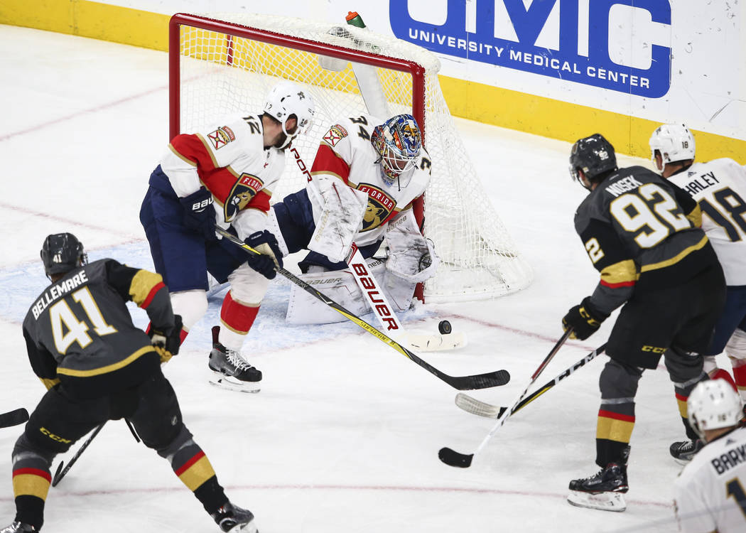 Florida Panthers goalie James Reimer (34), with help from Ian McCoshen (12), defends as the Golden Knights attempt to score during an NHL hockey game at T-Mobile Arena in Las Vegas on Sunday, Dec. ...