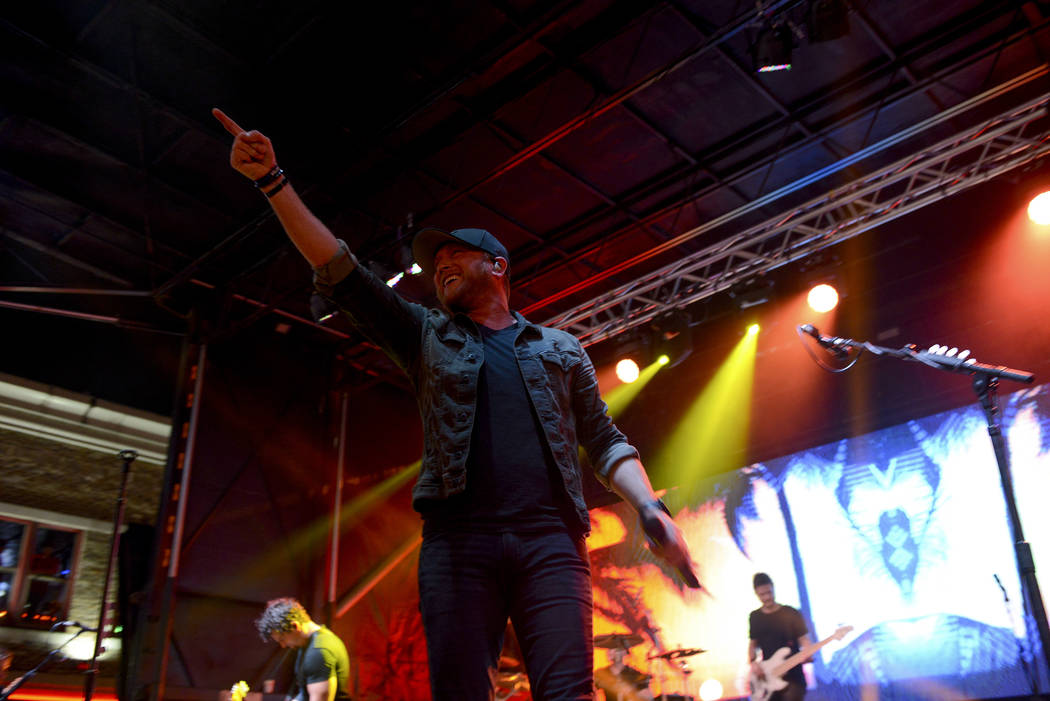 Cole Swindell performs Oct. 10 in Nashville, Tenn. The country music star addressed the Route 91 Harvest tragedy from the stage that night and paid tribute to the victims. (Ben Neely)