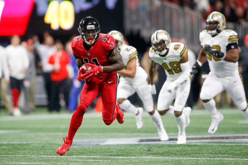 Dec 7, 2017; Atlanta, GA, USA; Atlanta Falcons wide receiver Julio Jones (11) runs after a catch against the New Orleans Saints in the first quarter at Mercedes-Benz Stadium. Mandatory Credit: Bre ...