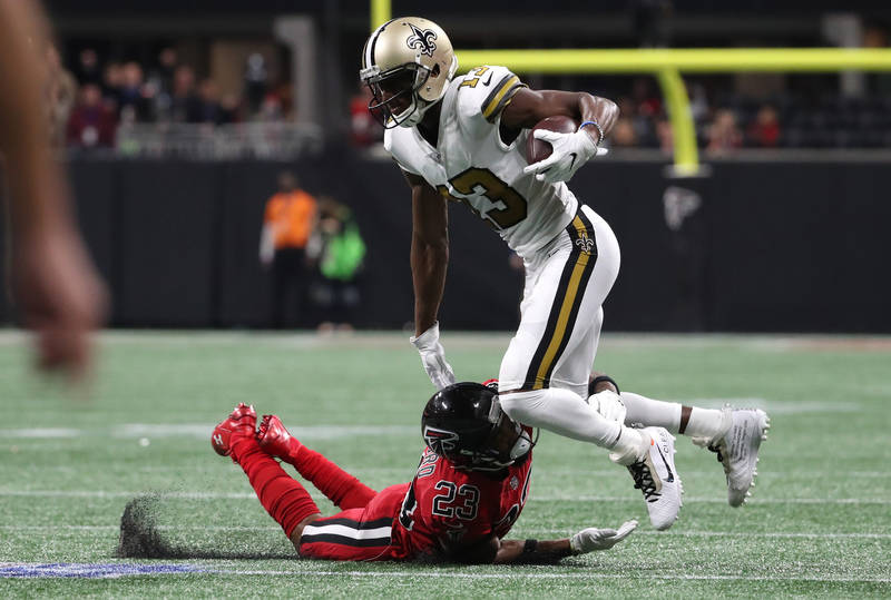 Dec 7, 2017; Atlanta, GA, USA; New Orleans Saints wide receiver Michael Thomas (13) is tackled by Atlanta Falcons cornerback Robert Alford (23) after a catch by Thomas in the first quarter at Merc ...