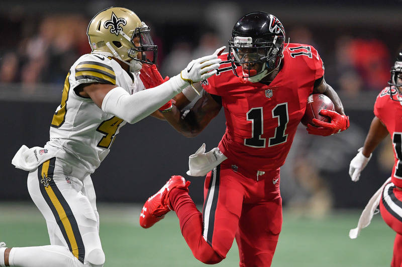 Dec 7, 2017; Atlanta, GA, USA; Atlanta Falcons wide receiver Julio Jones (11) runs after a catch against the New Orleans Saints safety Marcus Williams (43) during the first half at Mercedes-Benz S ...