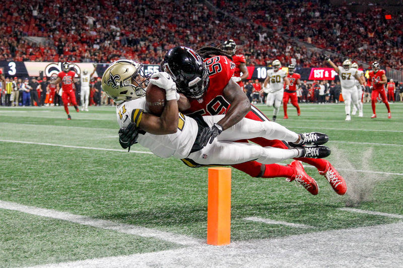 Dec 7, 2017; Atlanta, GA, USA; New Orleans Saints wide receiver Tommylee Lewis (11) dives in for a touchdown while being hit by Atlanta Falcons linebacker De'Vondre Campbell (59) in the second qua ...