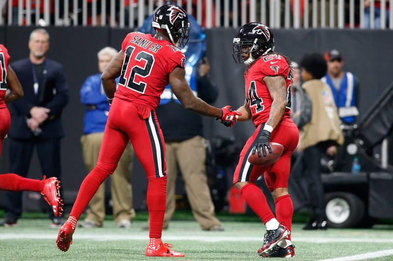 Dec 7, 2017; Atlanta, GA, USA; Atlanta Falcons running back Devonta Freeman (24) celebrates a touchdown run with wide receiver Mohamed Sanu (12) against the New Orleans Saints in the second quarte ...