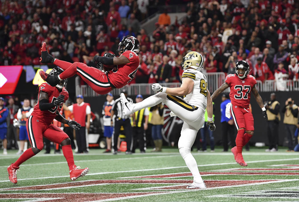 Atlanta Falcons middle linebacker Deion Jones (45) intercepts a ball in the end zone ahead of New Orleans Saints tight end Josh Hill (89) during the second half of an NFL football game, Thursday,  ...