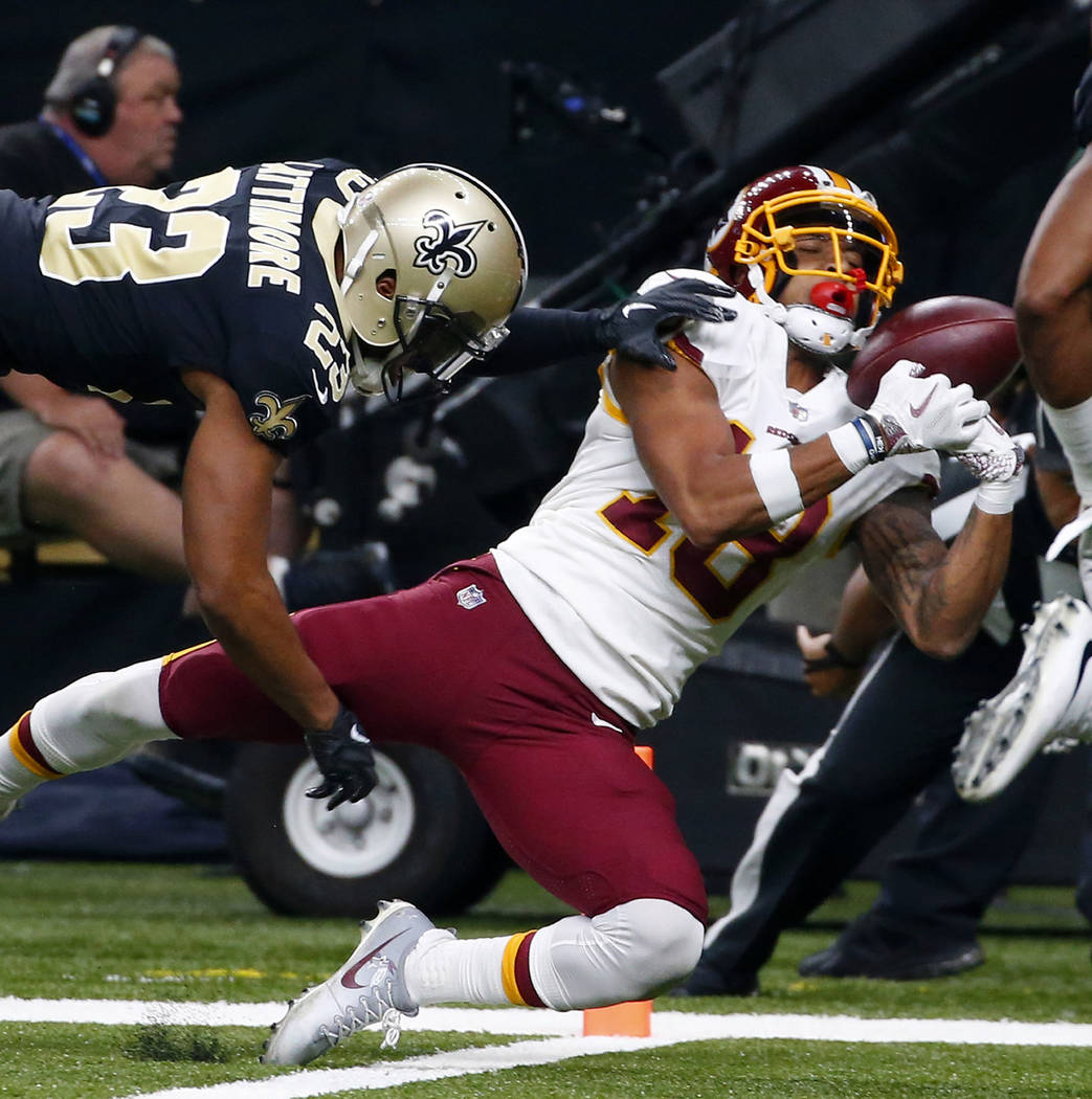 New Orleans Saints cornerback Marshon Lattimore (23) breaks up a pass intended for Washington Redskins wide receiver Josh Doctson (18) in the first half of an NFL football game in New Orleans, Sun ...