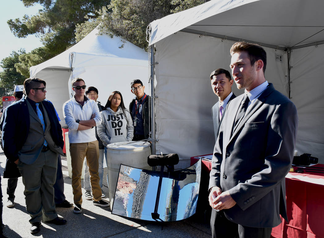 Dylan Nanni, mechanical engineering senior, and his two peers, Kobe-Dean Neuhaus and Norberto Torres-Reyes, presented Sol-Hydrator, a personal portable water distillation unit which uses the power ...