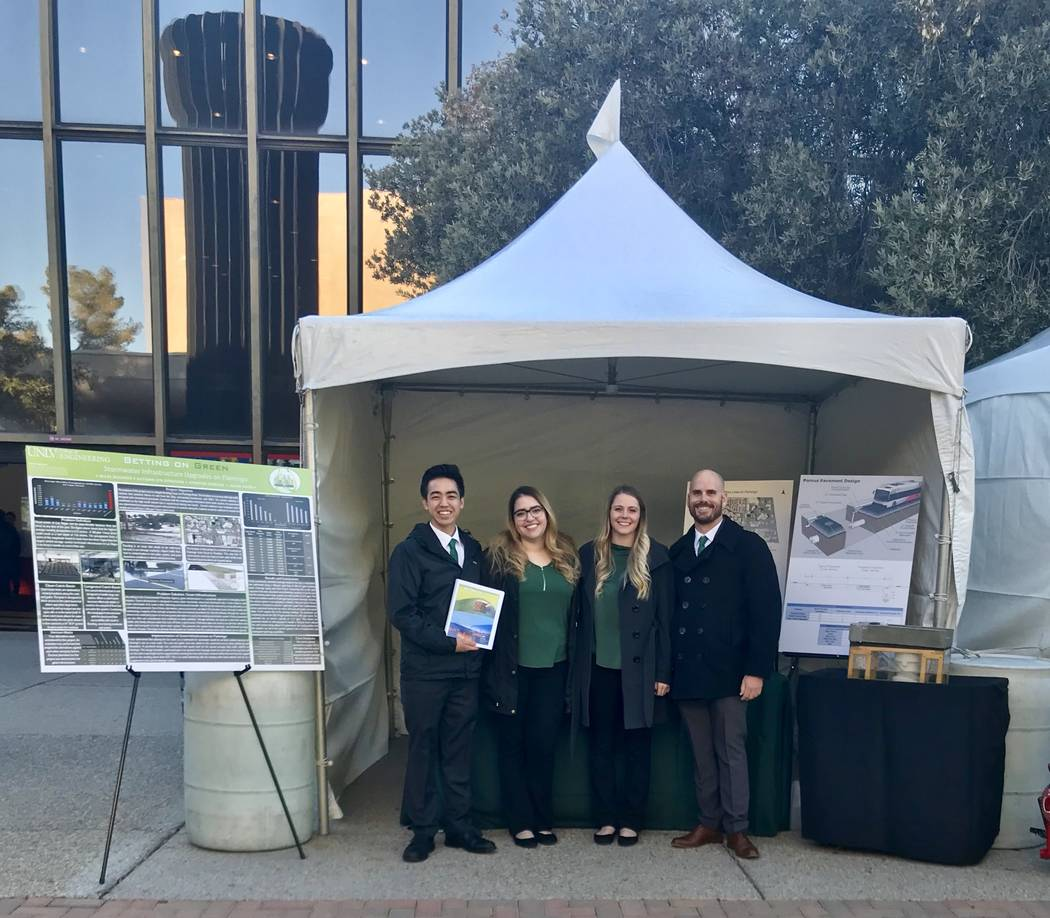 "From left to right: Jason Shon, Jennifer Jarquin, Autumn Donovan and Miles Buckner present their project titled ""Betting on Green: Infrastructure Redesign for the Future of Las Vegas"" at the annua ..."