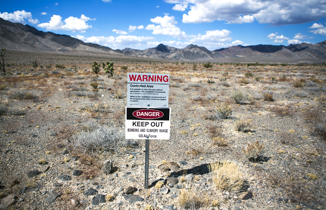 A sign is posted in the Desert National Wildlife Refuge warning travelers not to trespass on the gunnery range is seen Friday, Sept. 30, 2016. The Air Force prepares to hold public meetings on a p ...