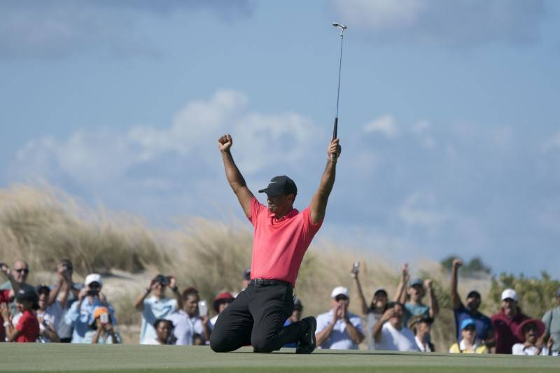 December 3, 2017; New Providence, The Bahamas; Tiger Woods celebrates after making his eagle putt on the seventh hole during the final round of the Hero World Challenge golf tournament at Albany.  ...