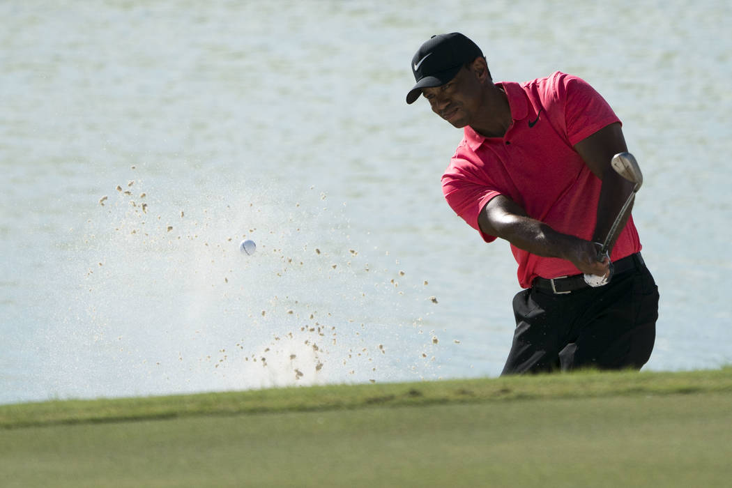 December 3, 2017; New Providence, The Bahamas; Tiger Woods hits his bunker shot on the 17th hole during the final round of the Hero World Challenge golf tournament at Albany. Mandatory Credit: Kyl ...