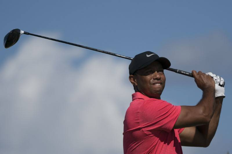 December 3, 2017; New Providence, The Bahamas; Tiger Woods hits his tee shot on the fourth hole during the final round of the Hero World Challenge golf tournament at Albany. Mandatory Credit: Kyle ...