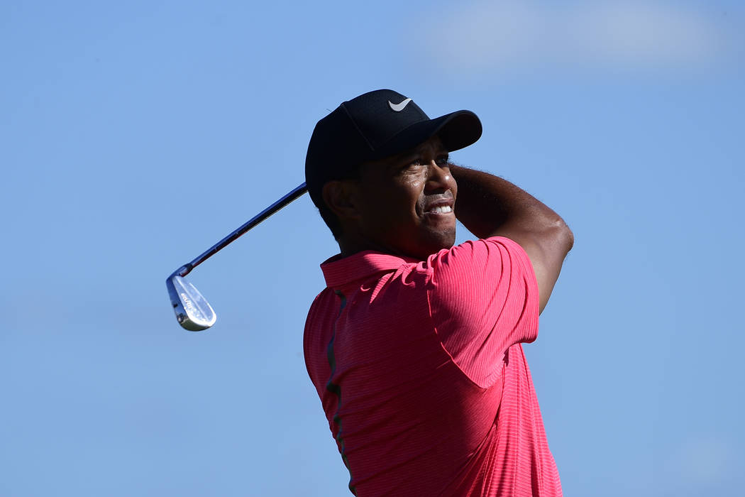 Tiger Woods tees off from the second hole of the Hero World Challenge at Albany Golf Club in Nassau, Bahamas, Sunday, Dec. 3, 2017. (AP Photo/Dante Carrer)