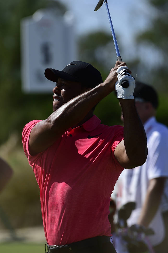 Tiger Woods tees off from the fifth hole of the Hero World Challenge at Albany Golf Club in Nassau, Bahamas, Sunday, Dec. 3, 2017. (AP Photo/Dante Carrer)