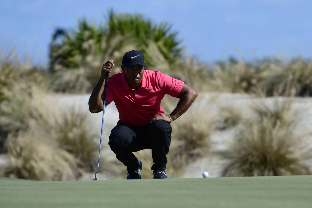 Tiger Woods lines up a putt on second hole during the final round of the Hero World Challenge golf tournament at Albany Golf Club in Nassau, Bahamas, Sunday, Dec. 3, 2017. (AP Photo/Dante Carrer)