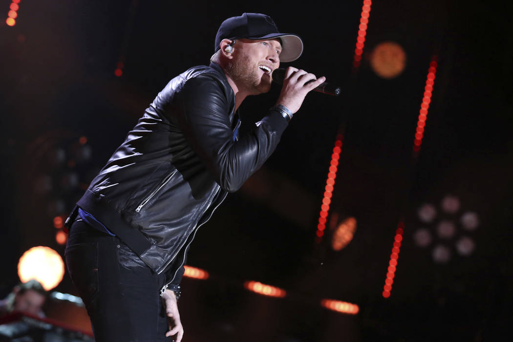 Artist Cole Swindell performs at the 2017 CMA Music Festival at Nissan Stadium on Thursday, June 8, 2017 in Nashville, Tenn. (Laura Roberts/Invision/AP)