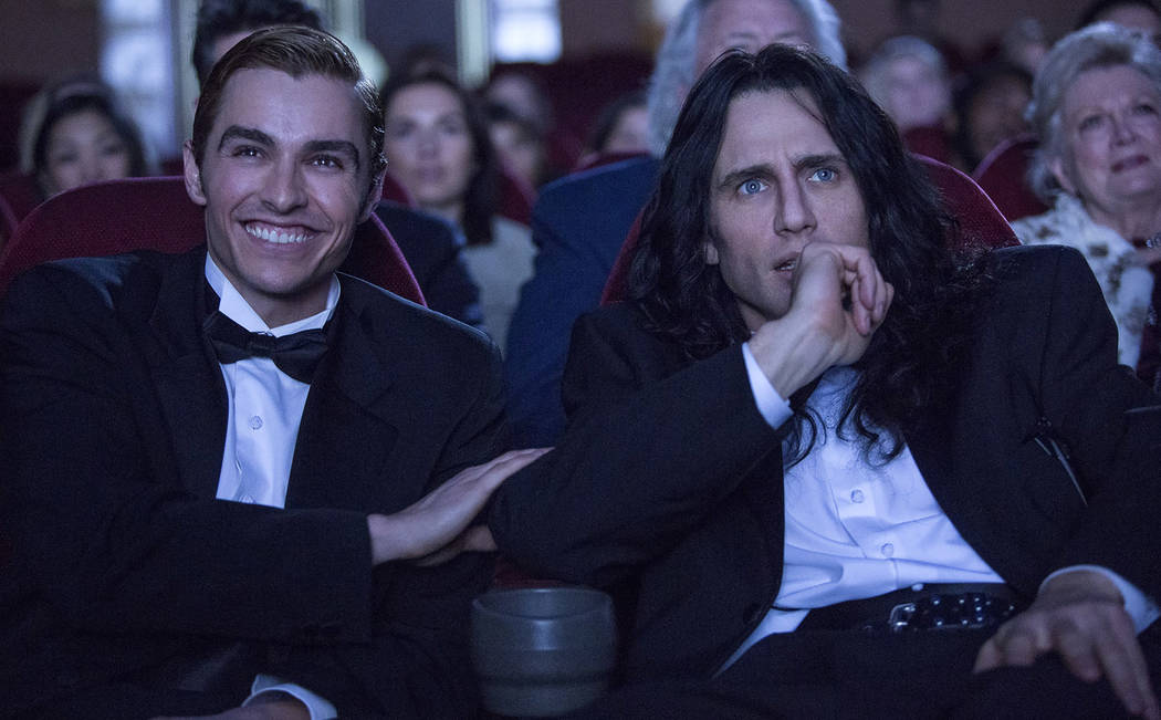 "Greg Sestero (Dave Franco), left, and Tommy Wiseau (James Franco) attend the premiere of ""The Room"" in a scene from ""The Disaster Artist."" (Justina Mintz via A24)"