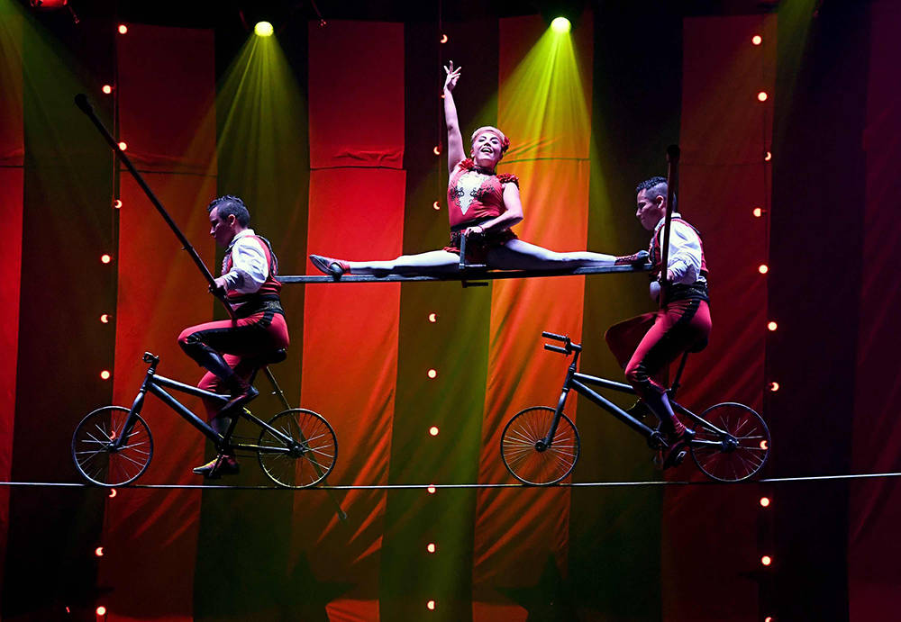 "The members of Los Lopez perform a high-wire act during the opening night of ""Circus 1903."" (Ethan Miller/Getty Images)"