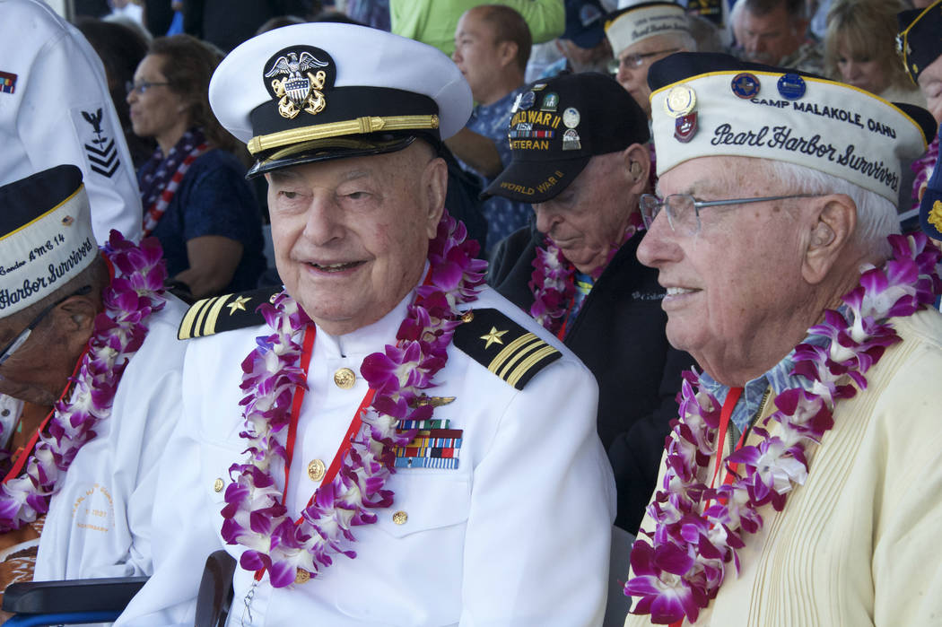 Arizona survivors, Louis Conter, left, and Herbert Elfring  before the ceremony at the Arizona Memorial in Honolulu, Hawaii., Thursday, Dec. 7, 2017.  Survivors gathered Thursday at the site of th ...
