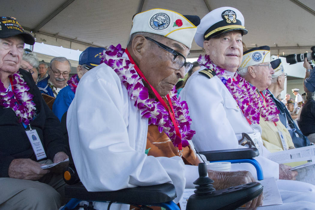 Raymond Chavez, left, 105, and Louis Conter before ceremonies at the Arizona Memorial in Honolulu, Hawaii., Thursday, Dec. 7, 2017.  Survivors gathered Thursday at the site of the Japanese attack  ...