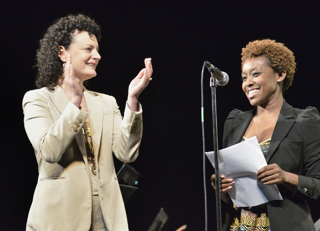 Zoe Thrall, studio director for Studio at the Palms, left, applauds as Qiana Conley, Los Angeles Chapter governor for The Recording Academy on behalf of the Grammy Foundation, reads an opening sta ...