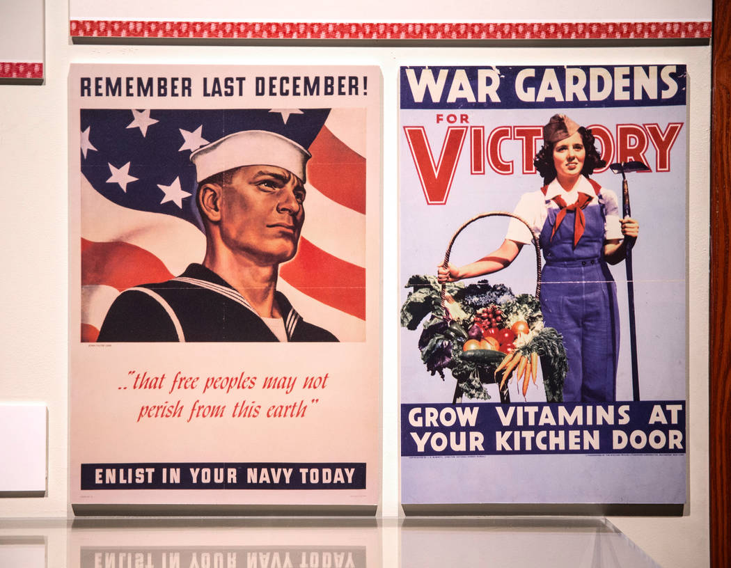 """World War II advertisements promoting military enlistment and self-sustainment practices at the new Springs Preserve exhibit, """"The Power of Children"""" on Wed., Dec. 13, 2017, in L ..."""