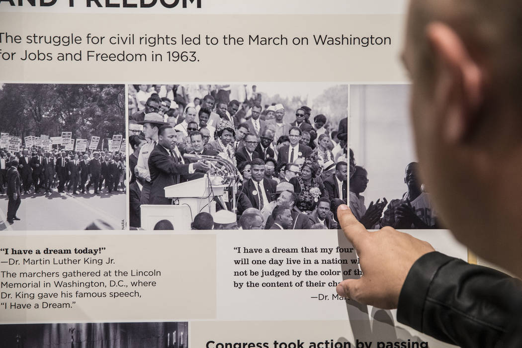 """Curator Aaron Micallef gives a tour of the new Springs Preserve exhibit, """"The Power of Children,"""" which focuses on the impact of Anne Frank, Ruby Bridges and Ryan White on Wed., Dec. 13, 2017, in  ..."""