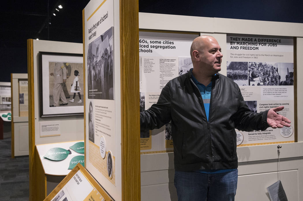 """Curator Aaron Micallef gives a tour of the new Springs Preserve exhibit, """"The Power of Children,"""" which focuses on the impact of Anne Frank, Ruby Bridges and Ryan White on Wed.,  ..."""