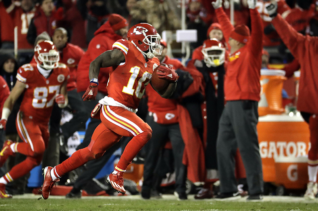 Kansas City Chiefs wide receiver Tyreek Hill (10) returns a kickoff ball for a touchdown during the first half of an NFL football game against the Oakland Raiders in Kansas City, Mo., Thursday, De ...