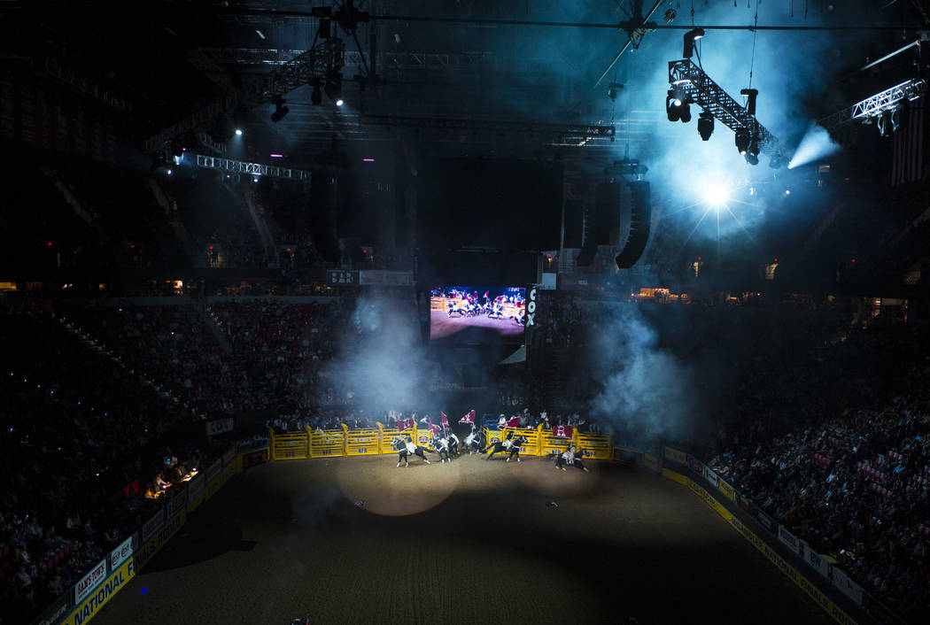 People on horseback enter the arena for during the opening ceremony on the first night of the National Finals Rodeo at the Thomas & Mack Center in Las Vegas on Thursday, Dec. 7, 2017. Chase St ...
