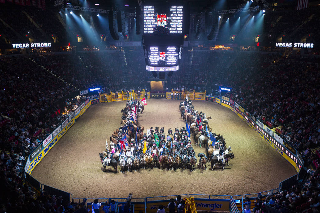 The names of the 58 victims killed in the October 1 shooting are displayed during the opening ceremony on the first night of the National Finals Rodeo at the Thomas & Mack Center in Las Vegas  ...