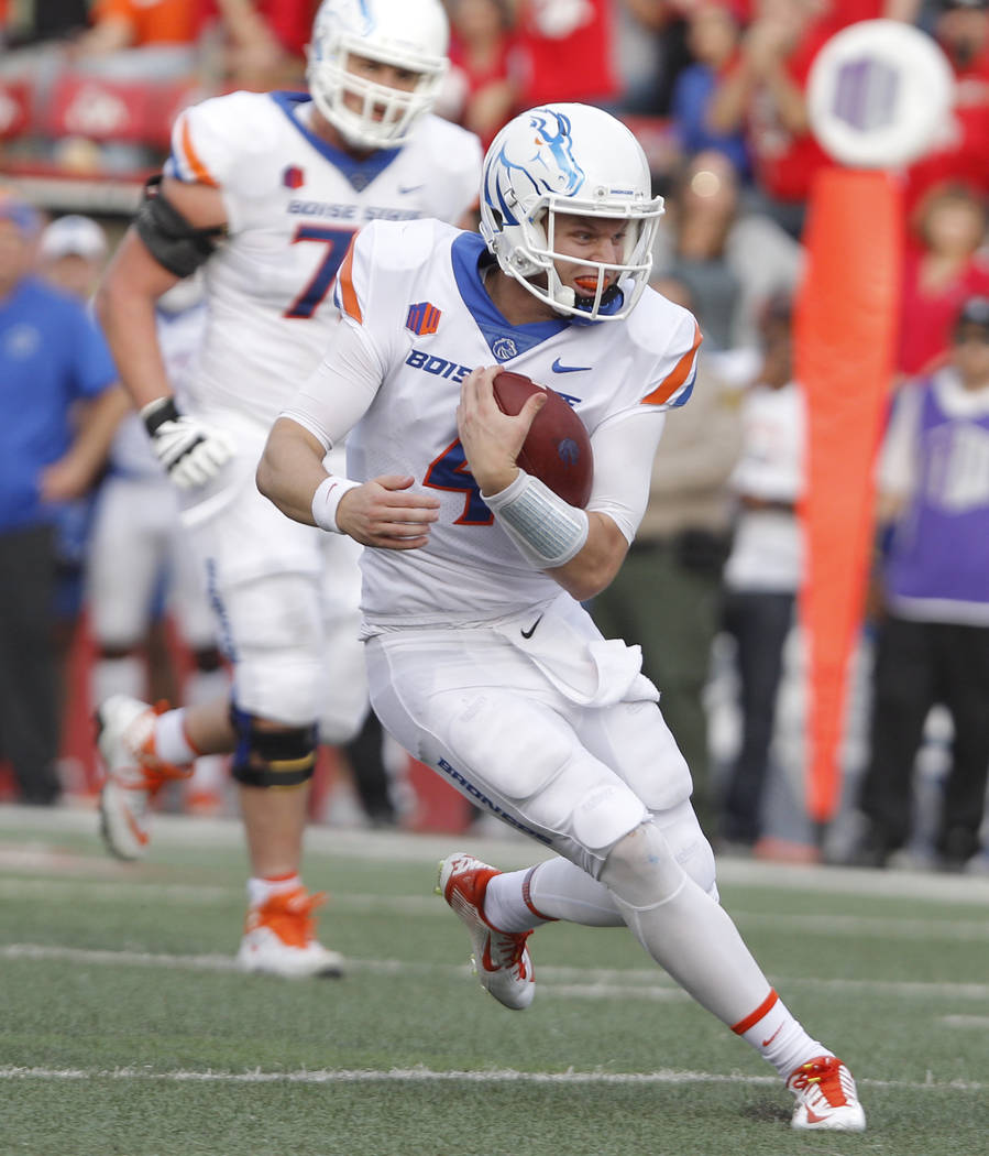 Boise State's Brett Rypien heads downfield against Fresno State during the second half of an NCAA college football game in Fresno, Calif., Saturday, Nov. 25, 2017. Fresno State won 28-17. (AP Phot ...