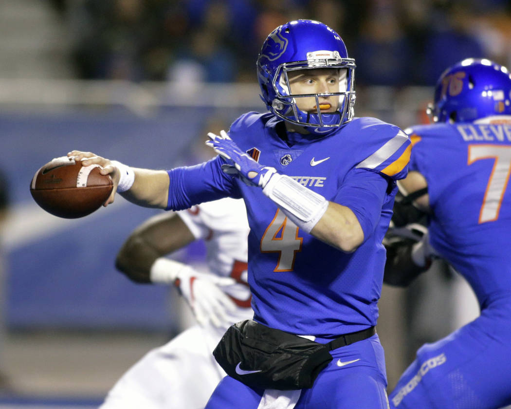 Boise State quarterback Brett Rypien (4) passes during the first half of an NCAA college football game against Fresno State for the Mountain West championship in Boise, Idaho, Saturday, Dec. 2, 20 ...