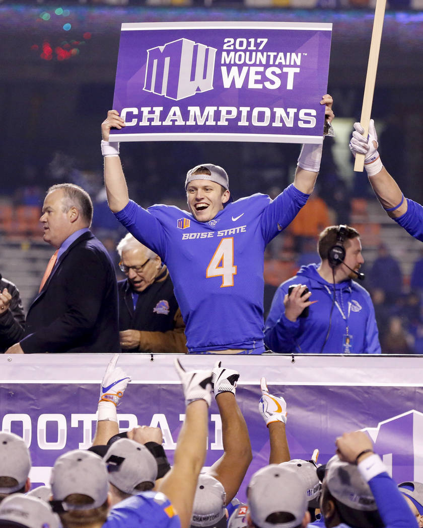 Boise State quarterback Brett Rypien holds up a champions sign after their 17-14 win over Fresno State in an NCAA college football game for the Mountain West championship in Boise, Idaho, Saturday ...