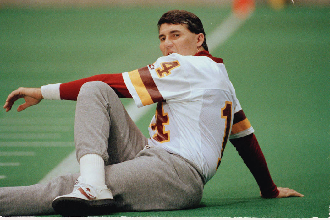 Redskins quarterback Mark Rypien tests his right ankle during warm-ups at Friday, Jan. 24, 1992 practice in Bloomington. Rypien sprained his ankle Thursday but appeared to be fine on Fridat. (AP P ...