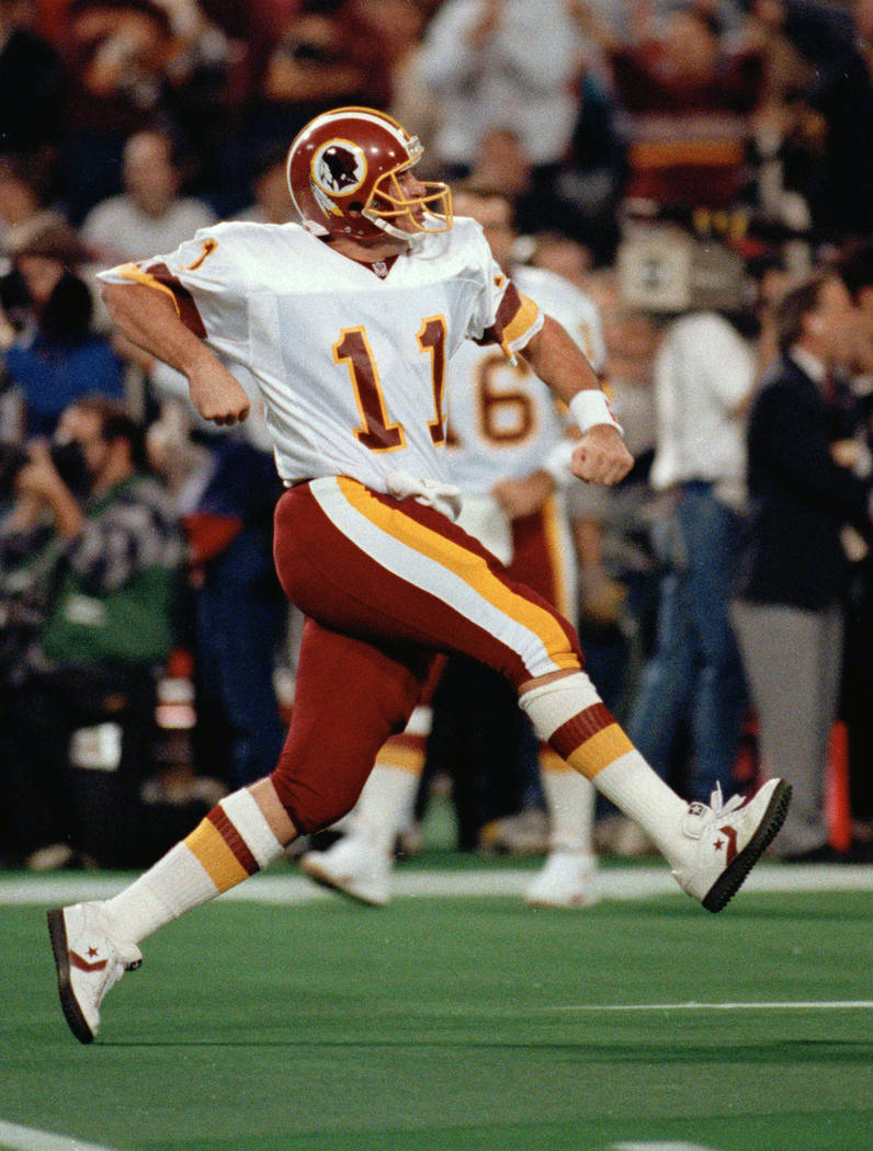 Washington Redskins quarterback Mark Rypien reacts after Gerald Riggs ran the ball into the end zone for a second quarter touchdown against the Buffalo Bills in Super Bowl XXVI in Minneapolis, Min ...