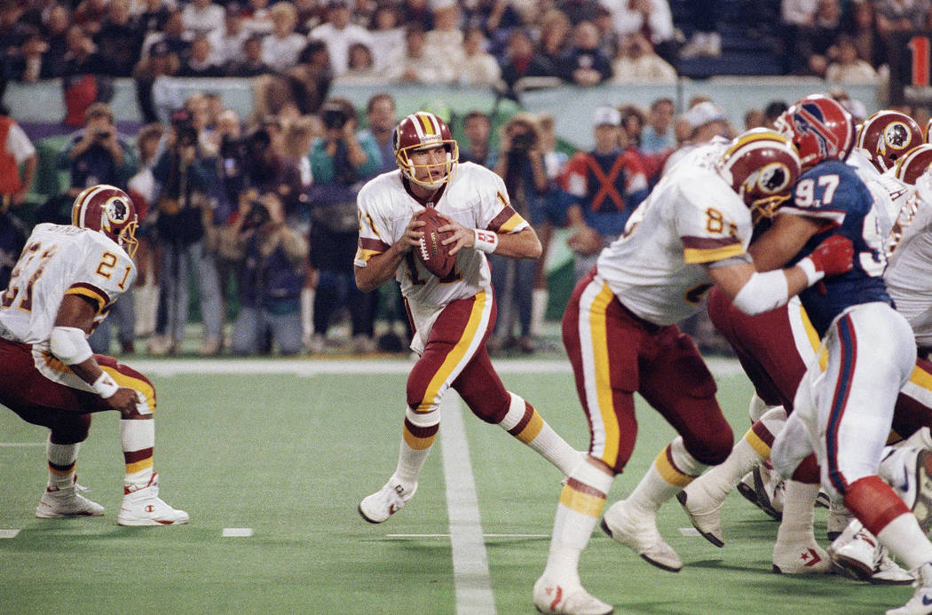 Washington Redskins' Don Warren (85) keeps Buffalo Bills Cornelius Bennet (97) away from Redskins quarterback Mark Rypien during second quarter action Super Bowl XXVI football game in Minneapolis  ...