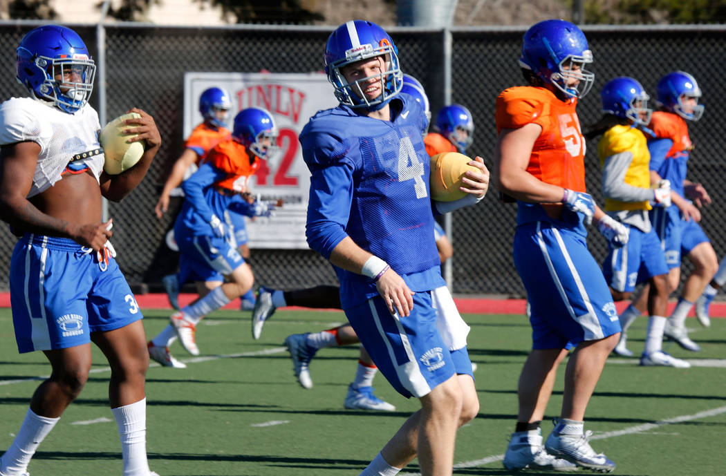 Boise State Broncos quarterback Brett Rypien (4) and his teammate warm up during a football practice at UNLV Rebel Park in Las Vegas, Wednesday, Dec. 13, 2017. Boise State Broncos and Oregon Ducks ...