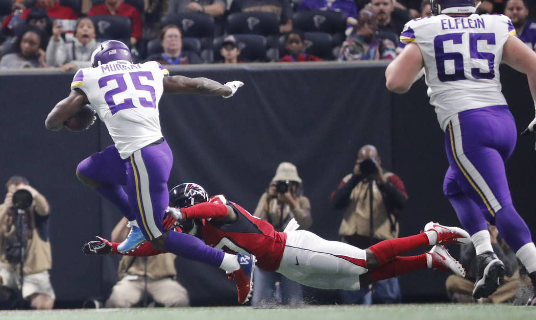 Minnesota Vikings running back Latavius Murray (25) runs [past Atlanta Falcons free safety Damontae Kazee (27) during the first half of an NFL football game, Sunday, Dec. 3, 2017, in Atlanta. (AP  ...
